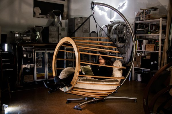 A lady sat in a Hive chair, lost to the world engrossed deep inside a book about design craft...