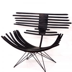 The dark and crispy Carbon chair contrasts strongly against a light background