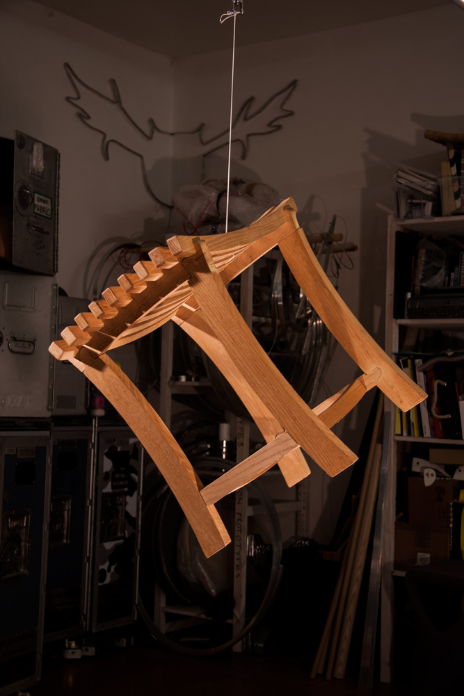 A Diddy stool suspended mid-air in a workshop, looking super-fly.