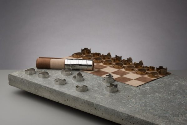 Rawstudio chess set shown with half of the leather board rolled, to demonstrate storage