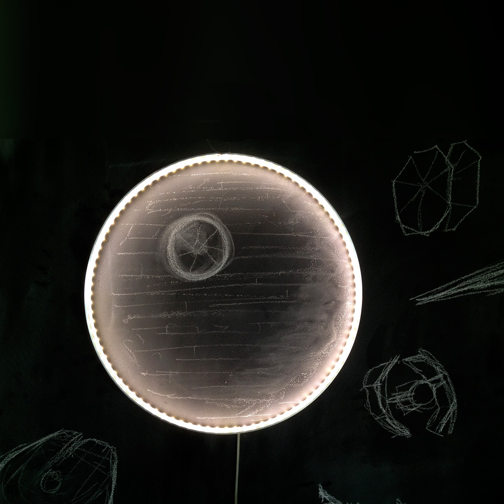 A Hoop light, placed on a chalk drawing of the Death Star - featured in the film Star Wars - brings life to the image, adding depth and texture to the image.